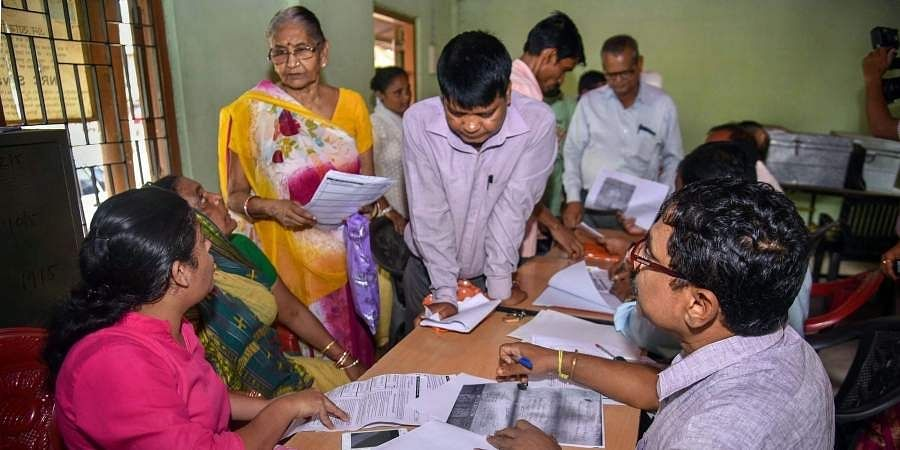 People verify the National Register of Citizens NRC forms to file claims and objections at an NRC centre in Guwahati Tuesday Spet 25 2018. | PTI