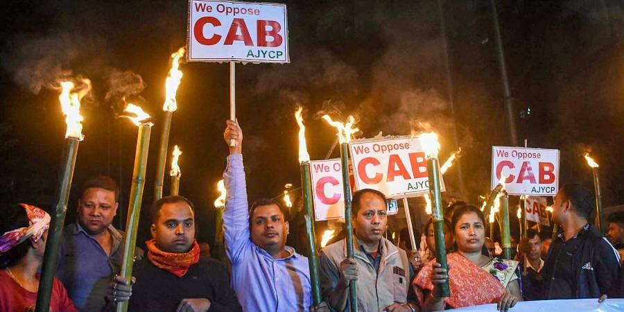Asom Jatiyatabadi Yuba Chatra Parishad (AJYCP) members participate in a torchlight rally to protest against Citizenship Amendment Bill in Guwahati Thursday Dec. 5 2019. (Photo | PTI)