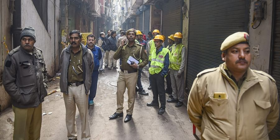 Policemen fire tenders and BSES Power members at the spot where minor fire broke out in the same factory building in Anaj Mandi where 43 workers died on Sunday in New Delhi Monday Dec. 9 2019. (Photo | PTI)