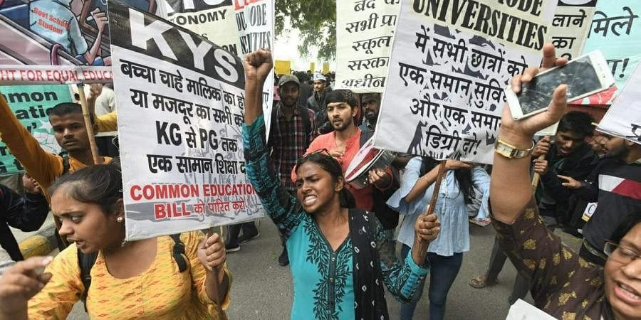 JNU students and All india students association shouting slogans during the protest march demanding fee hike, in New Delhi on Saturday.
