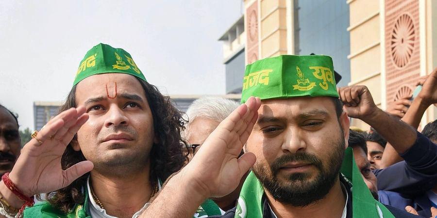 RJD leaders Tejashwi Yadav (front) and Tej Pratap wearing party caps during the open session of Rashtriya Janata Dal at Bapu Sabhagar in Patna Tuesday Dec. 10 2019. (Photo   PTI)