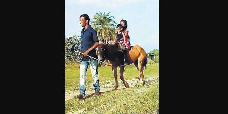 Jatish Mistry taking his daughters on a horse ride in Mayurbhanj