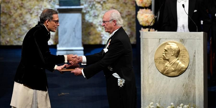 Abhijit Banerjee (R) receives the Sveriges Riksbank Prize in Economic Sciences in Memory of Alfred Nobel from King Carl Gustaf of Sweden, during the Nobel Prize award ceremony at the Stockholm Concert Hall, in Stockholm.