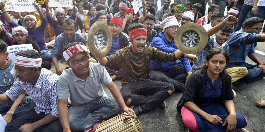 College students raise slogans in protest against the Citizenship Amendment Bill CAB during a strike in Guwahati Wednesday
