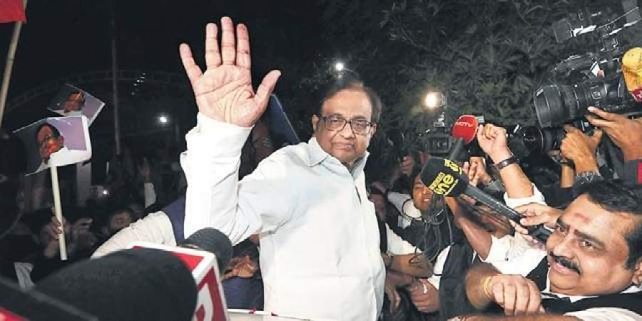 Congress leader P Chidambaram waves to supporters after release.