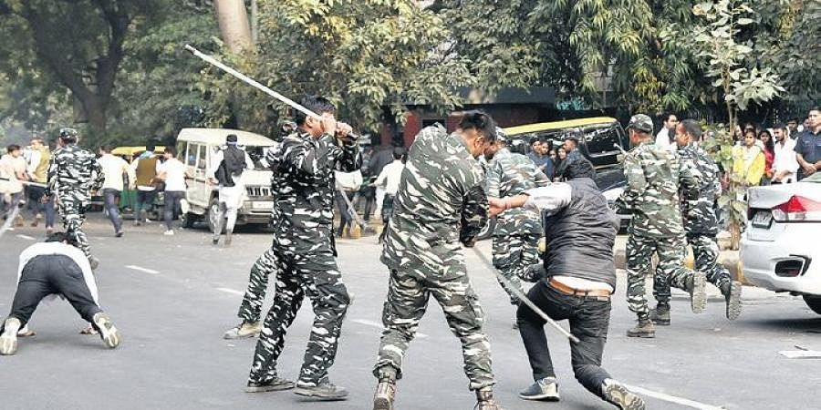 Police disperse NSUI activists during an anti-government demonstration