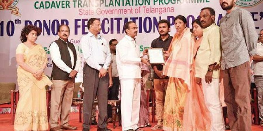 Health Minister Eatala Rajender felicitating the family of organ donors enlisted in the Jeevnadan Organ Donation Scheme, in Hyderabad on Tuesday