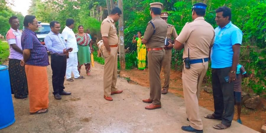Police inspecting the spot where two people were injured after an unidentified object went off at Hanumanthapuram near Maraimalai Nagar in Kancheepuram on Tuesday evening.
