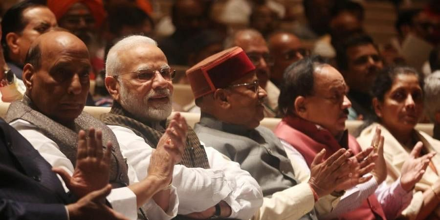 Prime Minister Narendra modi with other ministers during the BJP parliamentary party meeting at parliament house in New Delhi on Wednesday