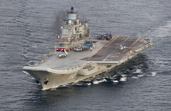 Russia's sole aircraft carrier catches fire in port, say media reports