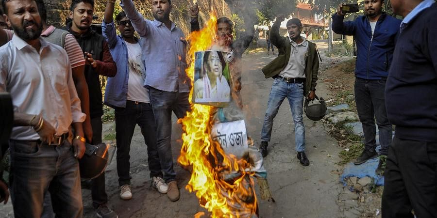 All Assam Students' Union AASU activists burn an effigy of Guwahati Lok Sabha MP Queen Ojha during a protest against the Citizenship Amendment Bill in Guwahati Tuesday Dec. 10 2019. (Photo | PTI)