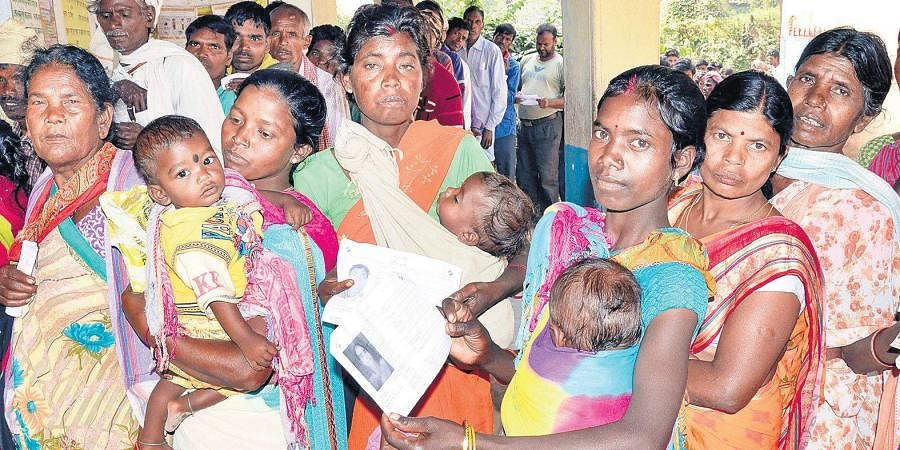 Women wait to cast their votes at a polling station at Bhandra block in Lohardaga district, Jharkhand.