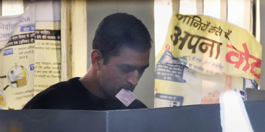 Former Indian cricket captain MS Dhoni casts his vote at a polling station during the third phase of Jharkhand Assembly elections, in Ranchi