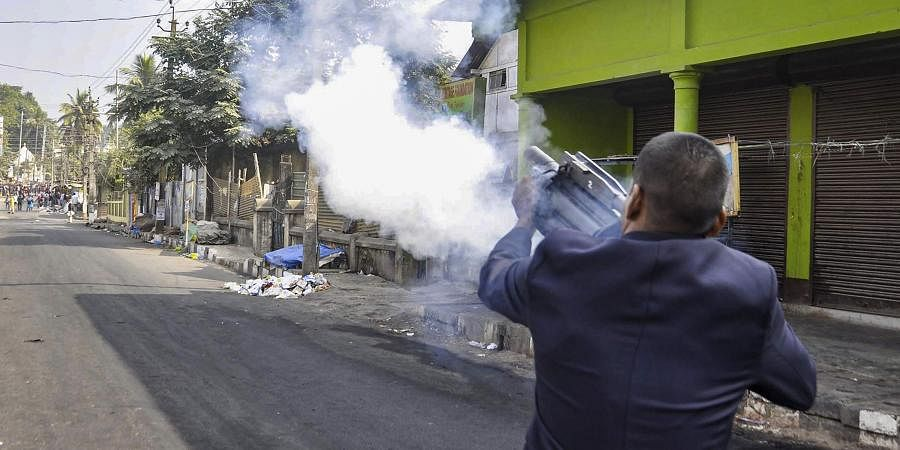 Police fire teargas shells to disperse protesters during their clashes as they march against the Citizenship Amendment Bill 2019 in Guwahati Thursday