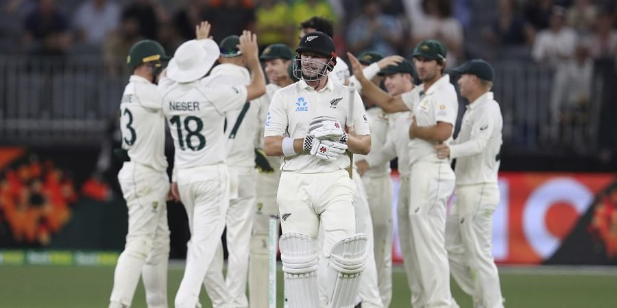 Australian players celebrate as New Zealand's Henry Nicholls, center, leaves the field after being dismissed. (Photo | AP)