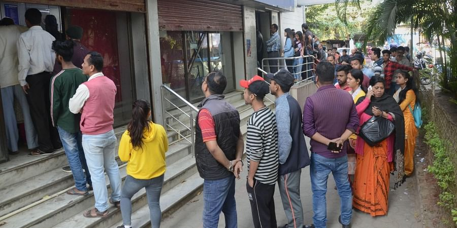 People queque up outside a bank ATM after rlaxation of curfew for five hours in Dibrugarh Friday Dec. 13 2019. (Photo   PTI)