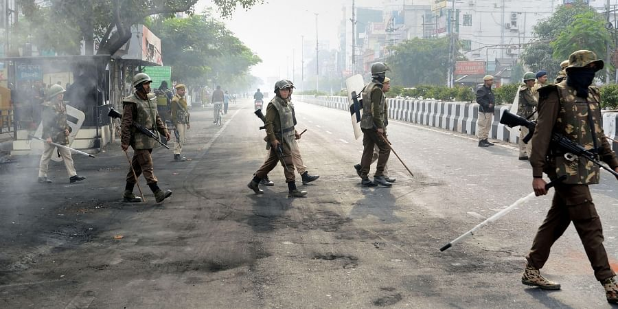 Security personnel guard during the 2nd day of the indefinite curfew imposed in the view of several anti-CAB protests in Guwahati Friday Dec. 13 2019. (Photo |PTI)