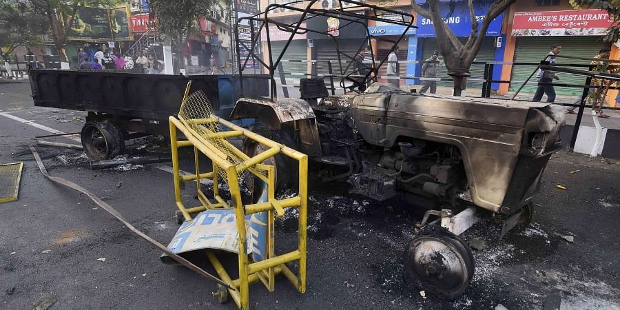 A charred tractor which was reportedly set on fire by the protestors during a demonstration against the Citizenship Amendment Bill in Guwahati Friday Dec. 13 2019. (Photo | PTI)