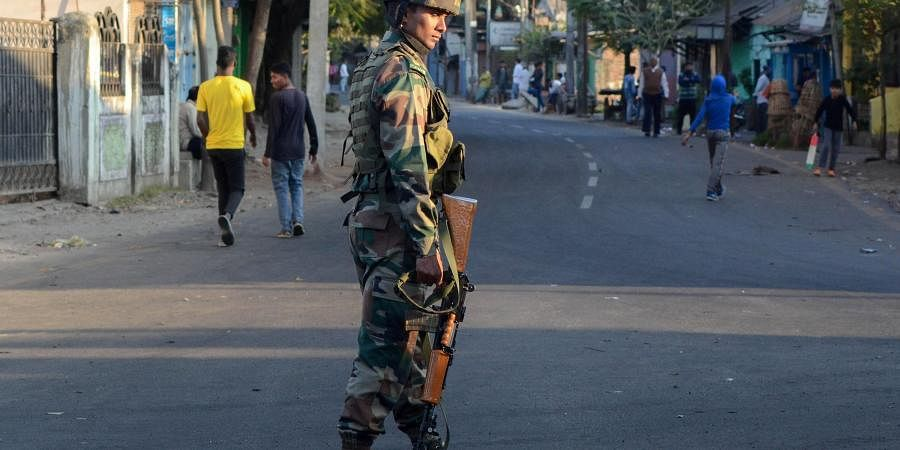 An Army jawan stands guard in a locality during relaxation of curfew in Dibrugarh Friday Dec. 13 2019. (Photo | PTI)