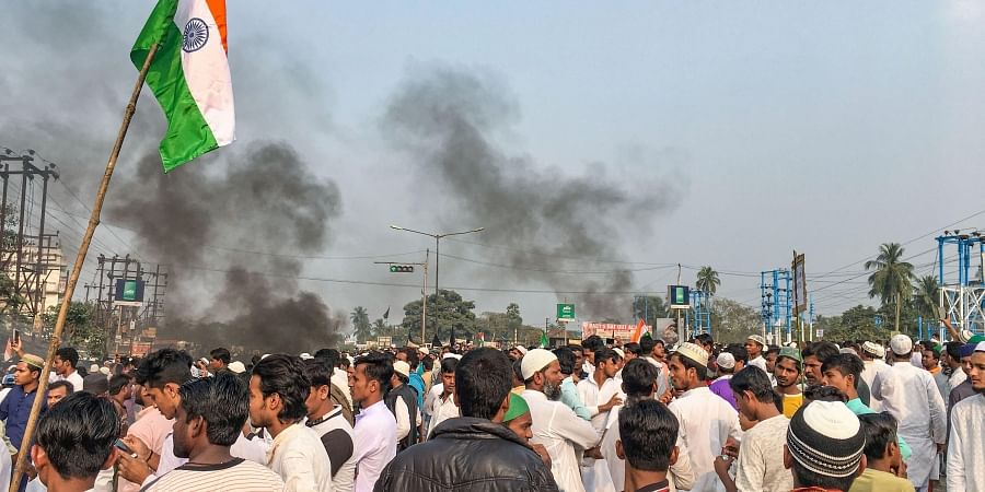 Muslim community members block the National Highway 6 during a protest against NRC and the Citizenship Amendment Bill in West Bengal s Uluberia district Friday Dec. 13 2019.   (Photo   PTI)
