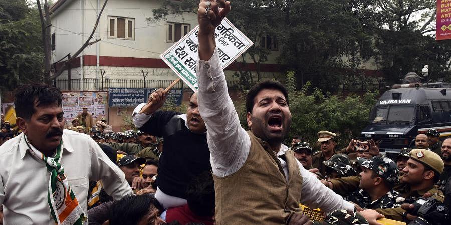 People shouting slogan against Citizenship Amendment Bill outside BJP Headquarte in New Delhi on Wednesday.