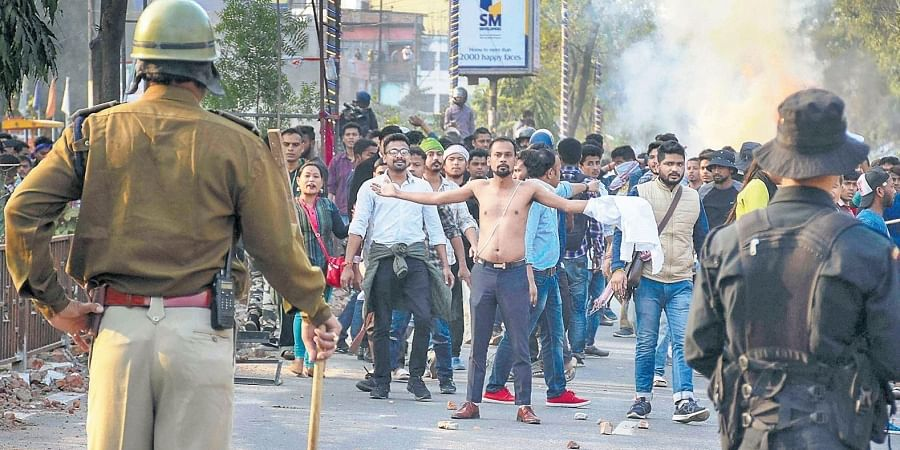 Protesters clash with the police during their march against the Citizenship Amendment Bill in Guwahati on Thursday.