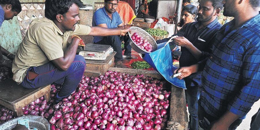A vendor selling onions at Swaraj Maidan Rythu Bazaar in Vijayawada on Thursday.