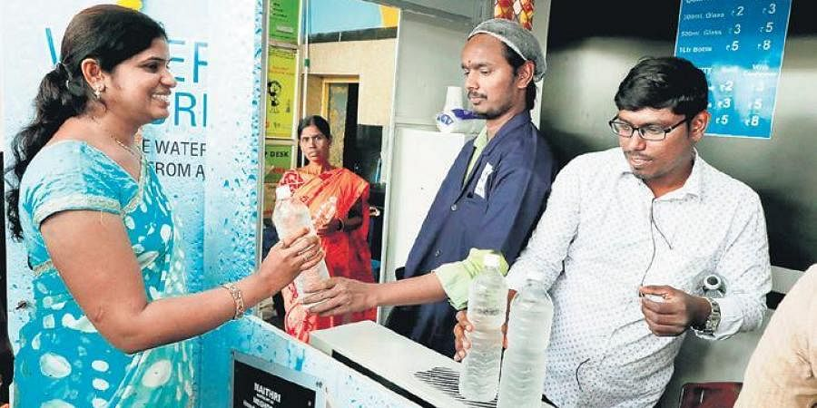 People buying water from the Atmospheric Water Generator kiosk installed at Secunderabad Railway Station on ThursdayPeople buying water from the Atmospheric Water Generator kiosk installed at Secunderabad Railway Station on Thursday