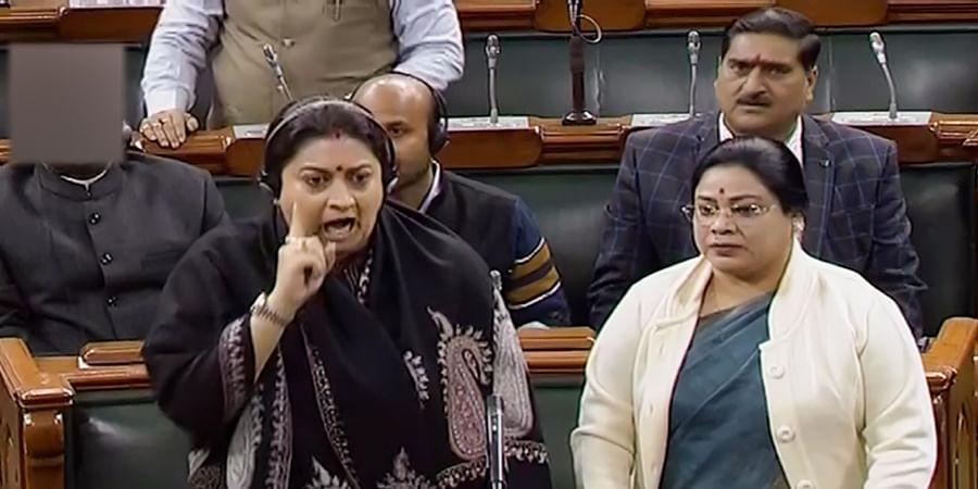 Union minister Smriti Irani speaks while protesting over Congress leader Rahul Gandhi's remarks on rape in the Lok Sabha during the Winter Session of Parliament in New Delhi Friday Dec. 13 2019. (Photo | Lok Sabha TV Screengrab)