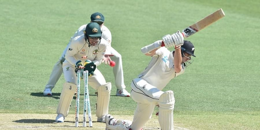 New Zealand's Mitchell Santner (R) is bowled out by Australia's Marnus Labuschagne on day three of the first Test cricket match between Australia and New Zealand at the Perth Stadium. (Photo | AFP)