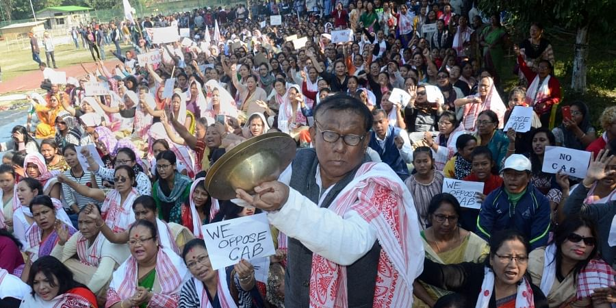 A man plays cymbals as protestors gather during an agiatation against the passing of Citizenship Amendment Bill in Dibrugarh Saturday Dec. 14 2019. (Photo | PTI)