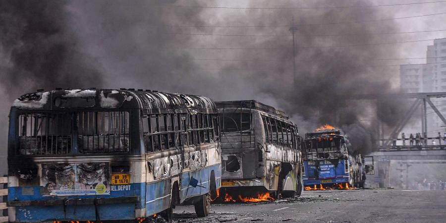 Vehicles torched by protestors agitating against the passing of Citizenship Amendment Bill CAB at Sanmtragachi in Howrah district of West Bengal Saturday Dec. 14 2019. (Photo | PTI)