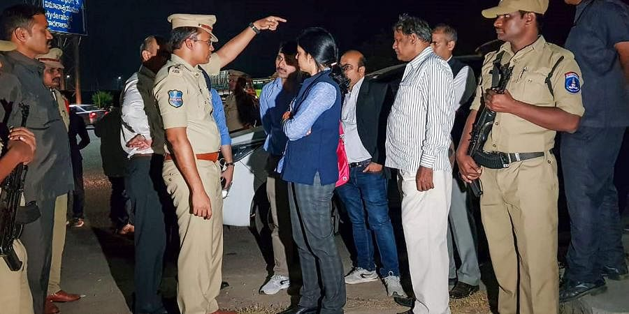 NHRC members visit the encounter site where yesterday police shot dead four accused involved in the rape-and-murder case of a woman veterinarian at Shamshabad in Hyderabad Saturday Dec. 7 2019. (Photo   PTI)