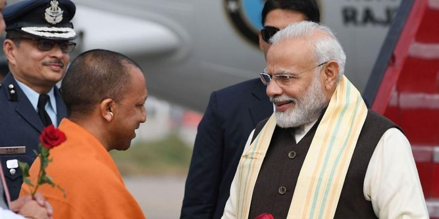 Prime Minister Narendra Modi being received by Uttar Pradesh Chief Minister Yogi Adityanath on his arrival in Kanpur Saturday Dec. 14 2019.