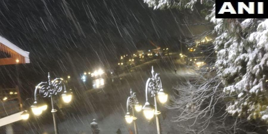 Visuals from Shimla as the city receives snowfall.