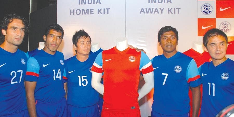 (From L) Indian football players Mahesh Gawli, Mehrajuddin Wadoo, Bhaichung Bhutia, NP Pradeep and Sunil Chhetri with the new home (in blue) and away kit for the football team.