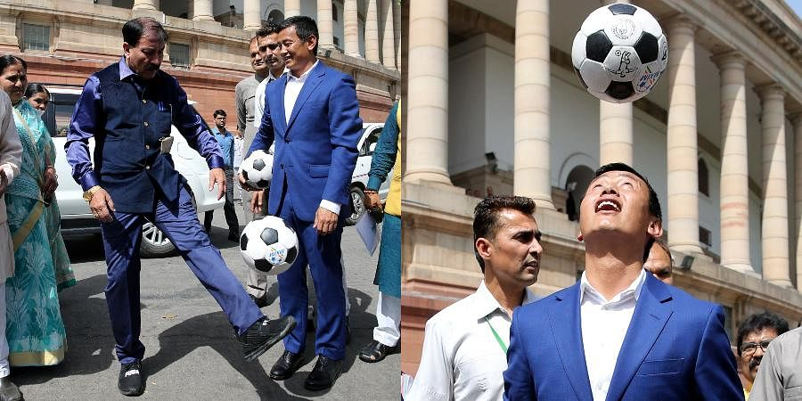 Former Indian fotballer Bhaichung Bhutia and MP Prasun Banerjee seen playing football after Lok Sabha speaker launches 'Mission XI million' to encourage children to play football at Parliament House in New Delhi.