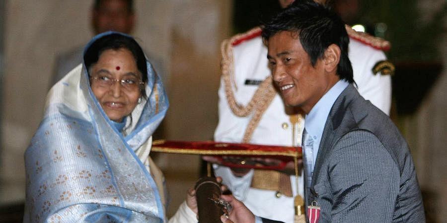 Then President Pratibha Patil presenting Padma Award to football player Bhaichung Bhutia at Rashtrapati Bhavan in New Delhi.