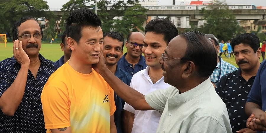 Former Indian football captain Bhaichung Bhutia having a chat with former Kerala player and coach TA Jaffar during the concluding ceremony of shoot the rain Football tournament organised by Tourism Professionals Club in Kochi.