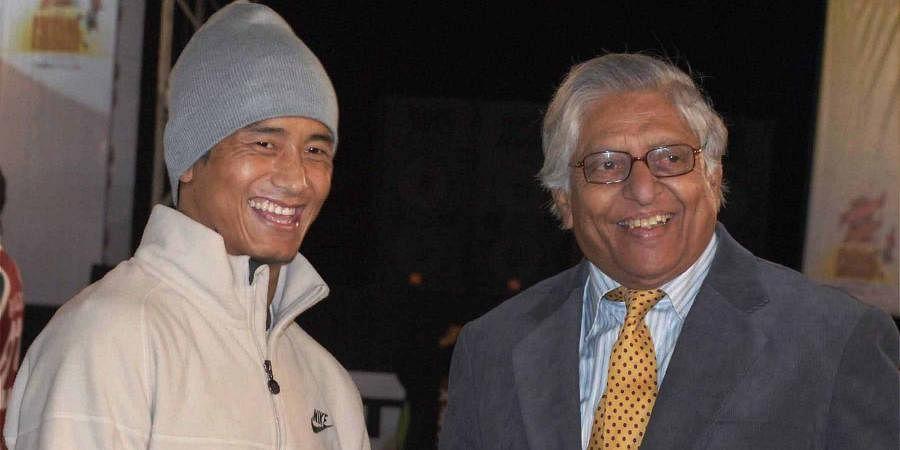 Indian football legend Bhaichung Bhutia meets former Olympian football player Chuni Goswami during Fustal Friendzy in Kolkata.