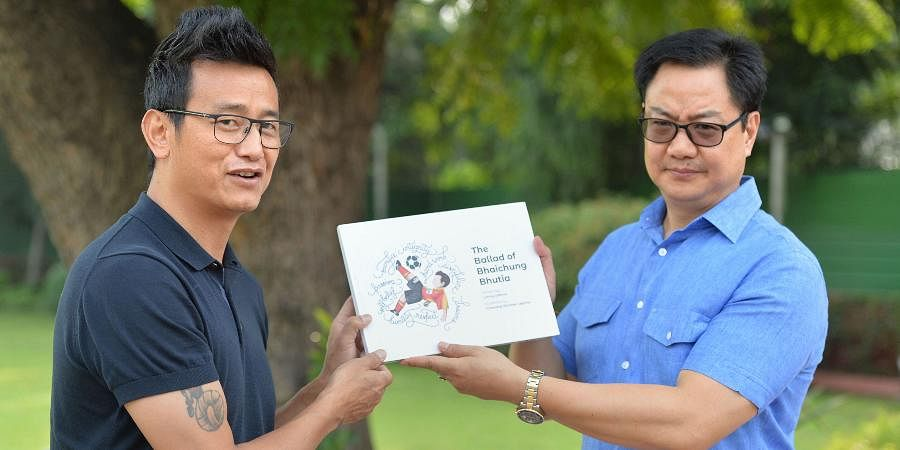 Sports Minister Kiren Rijiju and former India football captain Bhaichung Bhutia launch a coffee table book at former's residence in New Delhi.