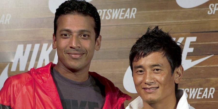 Indian tennis legend Mahesh Bhupati (L) with then Indian football team captain Bhaichung Bhutia at the Nike launch party in Mumbai.