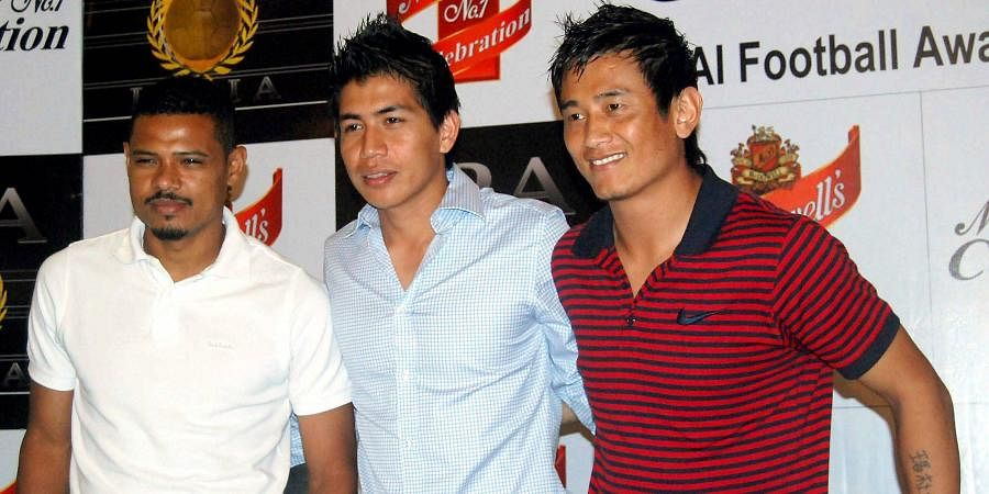 Then Indian football captain Bhaichung Bhutia with players Rennedy Singh (C) and Brazilian footballer Jose Ramirez Barreto (L) during the announcement of the nominations for the Football Players Association of India (FPAI) awards in Kolkata.