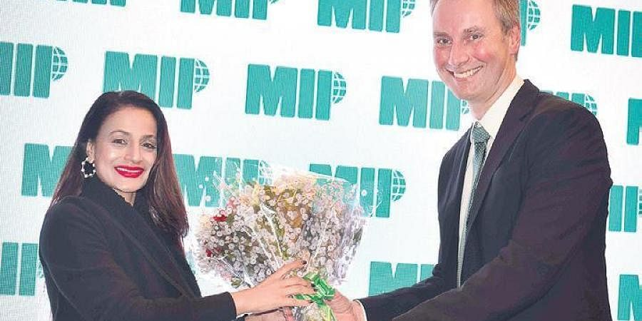 Ameesha Patel and Tor Lund, President and CEO, MIP Inc.