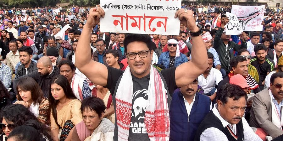 Assamese film actor Ravi Sharma holds a placard as he takes part in a hunger strike organised by All Assam Students Union AASU in protest against the passing of Citizenship Amendment Bill in Guwhati Friday Dec. 13 2019.
