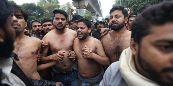 Students protesting outside the Jamia Millia Islamia University in New Delhi on Monday. (Photo | Shekhar Yadav/EPS)