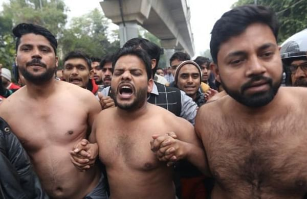 Jamia students stand shirtless to demand probe against Delhi Police