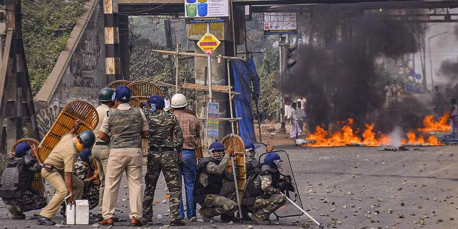 Police personnel attempt to disperse protestors during a demonstration against the passing of Citizenship Amendment Bill in India on December 14 2019.