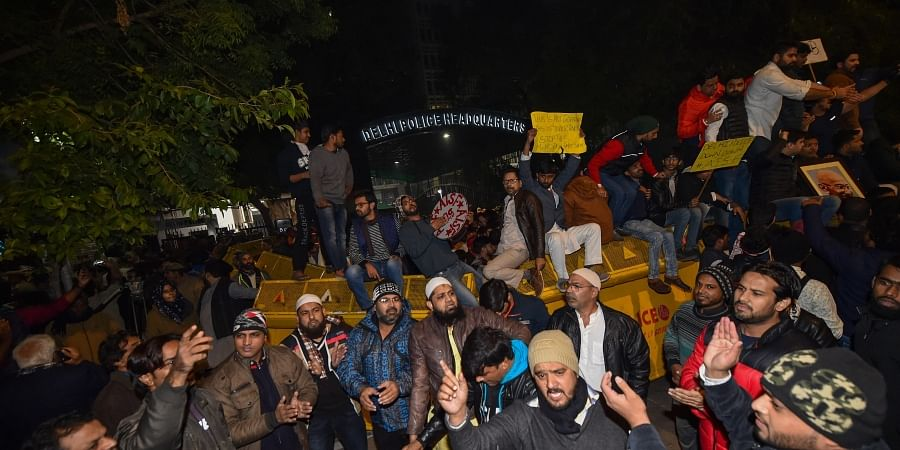 Students and other protest against the police action against students of the Jamia Millia Islamia University. at PHQ in New Delhi Sunday night Dec. 15 2019. (Photo | PTI)