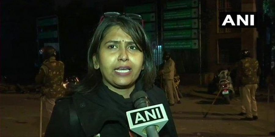 Journalist Bushra Sheikh said she was attacked and abused by a Delhi Police personnel while she was covering the protest in Jamia Millia Islamia University.(Photo | ANI)